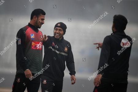 Mushfiqur Rahim, Nasir Hossain. Bangladesh cricketers Mushfiqur Rahim, centre, Nasir Hossain, left, and a teammate smile during a training session ahead of the Tri-Nation one-day international cricket series in Dhaka, Bangladesh