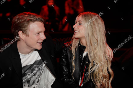 Patrick Gibson, Joanna Kuchta. Actor Patrick Gibson, left, and Joanna Kuchta attend the Dsquared2 men's Fall-Winter 2018-19 collection, that was presented in Milan, Italy, Sunday, Jan.14, 2018