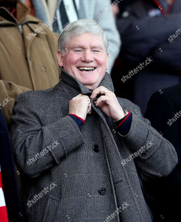 Patrick (Pat) Rice watches from the stands - smiling & laughing
