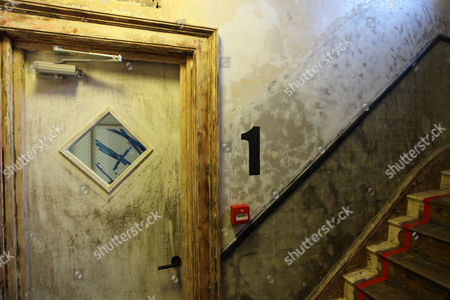 Rough Luxe Hotel.  Distressed walls and bare wooden treads on the staircases.