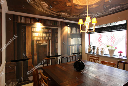 Rough Luxe Hotel - the breakfast room where the table is made from wood salvaged from Brighton Pier.