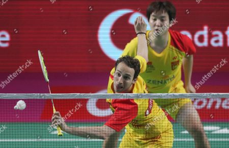 Denmark's Boe Mathias, front, and Korea's Kim Sa Rang of Bengaluru Blasters play against Indonesia's Markis Kido and Korea's Yoo Yeon Seong of Hyderabad Hunters during the men's doubles final of the Vodafone Premier Badminton League (PBL) in Hyderabad, India, . Bengaluru Blaster won 15-9, 15.10