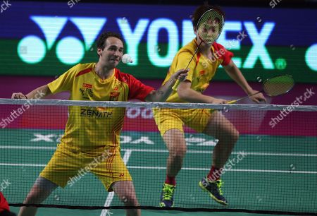 Stock Image of Denmark's Boe Mathias, left, and Korea's Kim Sa Rang, right, of Bengaluru Blasters play against Indonesia's Markis Kido and Korea's Yoo Yeon Seong of Hyderabad Hunters, during the mens doubles final of Vodafone Premier Badminton League (PBL) in Hyderabad, India, . Bengaluru Blasters won 15-9, 15.10