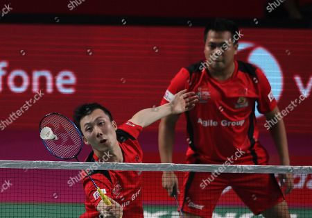 Stock Picture of Indonesia's Markis Kido, right, and Korea's Yoo Yeon Seong,left, of Hyderabad Hunters returns a shot to Denmark's Boe Mathias and Korea's Kim Sa Rang of Bengaluru Blasters during the mens doubles final of Vodafone Premier Badminton League (PBL) in Hyderabad, India, . Bengaluru Blaster won 15-9, 15.10