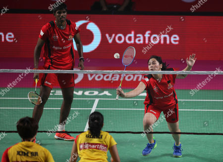India's Satwiksairaj Rankireddy, top left, and Indonesian player Pia Zebadiah Bernadet of Hyderabad Hunters returns a shot to Korea's Kim Sa Rang and India's Sikki Reddy of Bengaluru Blasters during the mixed doubles final of Vodafone Premier Badminton League (PBL) in Hyderabad, India, . Hyderabad Hunters won 15-11, 15.12