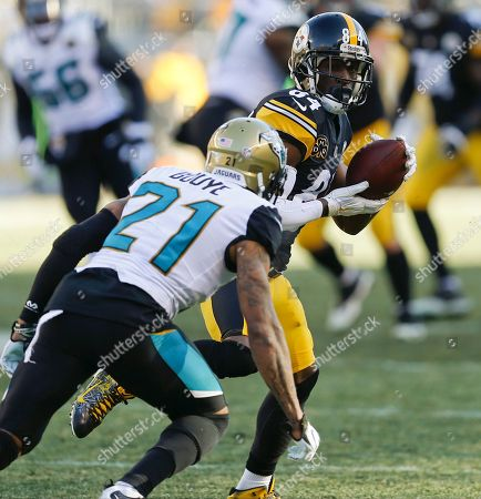 Antonio Brown, A J Bouye. Pittsburgh Steelers wide receiver Antonio Brown (84) catches a pass as he is defended by Jacksonville Jaguars cornerback A.J. Bouye (21) during the first half of an NFL divisional football AFC playoff game in Pittsburgh