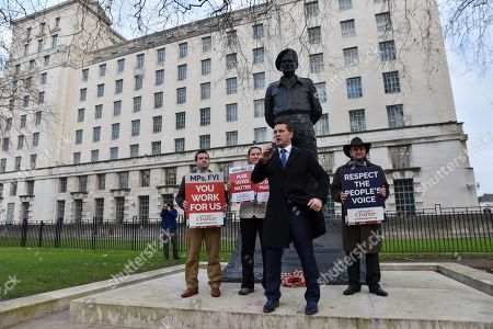 Steven Woolfe MEP. (centre). A 'non-partisan' Pro Brexit rally held opposite Downing Street.