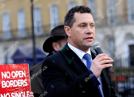 MEP Steven Woolfe addresses gathered people in Whitehall