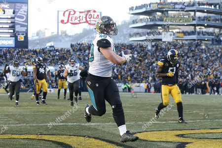 Jacksonville Jaguars fullback Tommy Bohanon catches a touchdown pass against the Pittsburgh Steelers in the second half of the NFL American Football game at Heinz Field in Pittsburgh, Pennsylvania, USA, 14 January 2018.