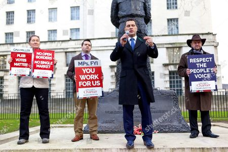 Stock Photo of Steven Woolfe MEP. (centre). Campaigners hold Pro-Brexit Rally organised by The People's Charter Foundation outside Downing Street in protest at Theresa May's proposed soft Brexit deal.