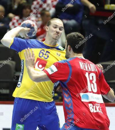 Stock Photo of Jim Gottfridsson (L) of Sweden in action against Milan Jovanovic (R) of  Serbia during the EHF European Men's Handball Championship 2018 group A match between Sweden  and  Serbia in Split, Croatia, 14 January 2018.