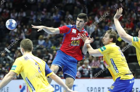 Milan Jovanovic (R) of  Serbia in action against  Frederic Pettersson (L) of  Sweden during the EHF European Men's Handball Championship 2018 group A match between Sweden  and  Serbia in Split, Croatia, 14 January 2018.