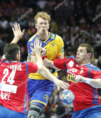 Simon Jeppson (R) of Sweden in action against Milan Jovanovic (L) of  Serbia during the  EHF European Men's Handball Championship 2018 group A match between Sweden  and  Serbia in Split, Croatia, 14 January 2018.