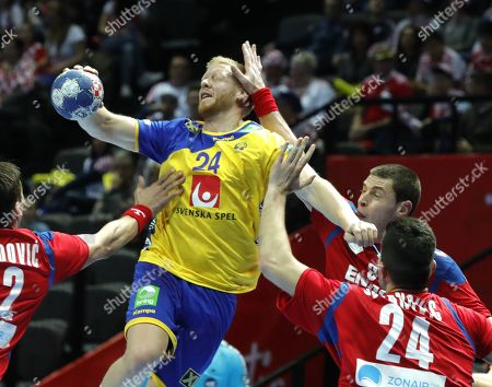 Jim Gottfridsson (L) of Sweden in action against Milan Jovanovic (R) of  Serbia during the EHF European Men's Handball Championship 2018 group A match between Sweden  and  Serbia in Split, Croatia, 14 January 2018.