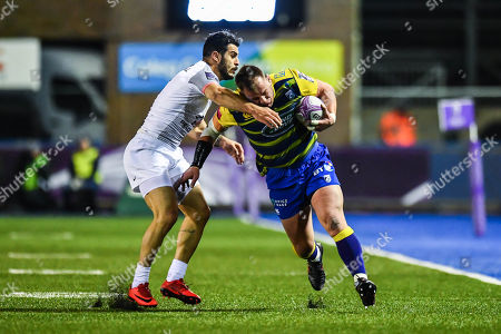Matthew Rees of Cardiff Blues is tackled by Sofiane Guitoune of Toulouse