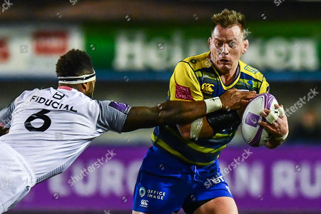 Matthew Rees of Cardiff Blues is tackled by Semi Kunatani of Toulouse