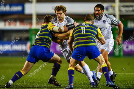 Richie Gray of Toulouse is tackled by Matthew Rees of Cardiff Blues