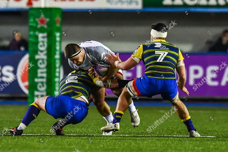 Piula Faasalele of Toulouse is tackled by Matthew Rees of Cardiff Blues