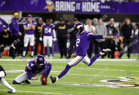 Kai Forbath, Ryan Quigley. Minnesota Vikings kicker Kai Forbath (2) kicks a field goal as Ryan Quigley (4) holds during the second half of an NFL divisional football playoff game against the New Orleans Saints in Minneapolis, . The Vikings defeated the Saints 29-24