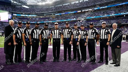 Jim Grant, Jim Mello, Greg Yette, Roy Ellison, Tom Symonette, Gene Steratore, Mark Steinkerchner, Scott Novak, Greg Meyer, Boris Cheek, Craig Wrolstad, Paul Weidner. NFL officials, from left, Jim Grant, Jim Mello, Greg Yette, Roy Ellison, Tom Symonette, Gene Steratore, Mark Steinkerchner, Scott Novak, Greg Meyer, Boris Cheek, Craig Wrolstad and Paul Weidner pose for a photo before an NFL divisional football playoff game between the Minnesota Vikings and the New Orleans Saints in Minneapolis