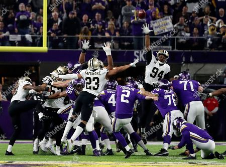 Stock Picture of Minnesota Vikings kicker Kai Forbath (2) kicks a field goal from the hold of Ryan Quigley during the second half of an NFL divisional football playoff game in Minneapolis