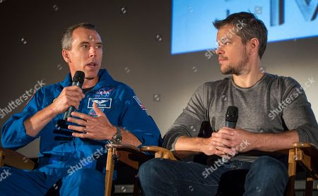 "In this image released by NASA, Astronaut Drew Feustel, left, speaks as actor Matt Damon listens during a question and answer session about NASA's journey to Mars and the film ""The Martian,"", at the United Artists Theater in La Canada Flintridge, Calif. The movie, based on the book by Andy Weir, gives a realistic view of the climate and topography of Mars. NASA scientists and engineers served as technical consultants on the film"