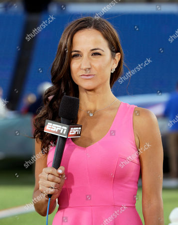 ESPN's Dianna Russini stands on the field before an NFL football game between the Buffalo Bills and the New York Jets, in Orchard Park, N.Y