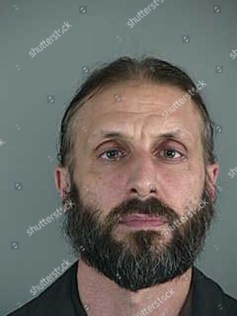 This booking photo released by the Lane County Sheriff's Office, shows Daniel James MacKay, a Eugene, Ore., priest, who was arrested, during a sting operation in which a detective posed as a minor and arranged a meeting with him