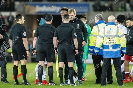 Jurgen Klopp, Manager of Liverpool shakes hands with Referee Neil Swarbrick
