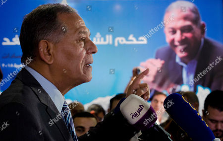 """Mohammed Anwar Sadat, nephew of Egypt's late leader Anwar Sadat and the leader of Reform and Development Party speaks during a press conference at the party headquarters, in Cairo, Egypt, . Sadat says he has decided not to run in the presidential election in March, saying the political """"climate"""" isn't conducive to campaigning"""