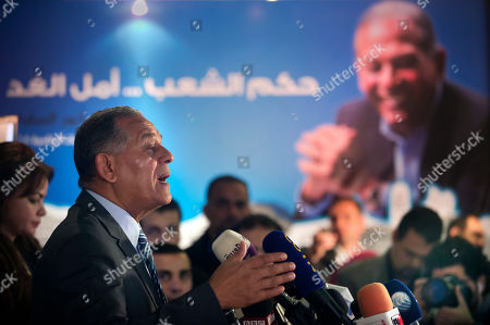 """Stock Photo of Mohammed Anwar Sadat, nephew of Egypt's late leader Anwar Sadat and the leader of Reform and Development Party speaks during a press conference at the party headquarters in Cairo, Egypt, . Sadat says he has decided not to run in the presidential election in March, saying the political """"climate"""" isn't conducive to campaigning. Arabic reads, """"people's ruling is the future hope"""