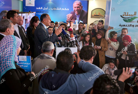 """Stock Image of Mohammed Anwar Sadat, nephew of Egypt's late leader Anwar Sadat and the leader of Reform and Development Party speaks during a press conference at the party headquarters in Cairo, Egypt, . Sadat says he has decided not to run in the presidential election in March, saying the political """"climate"""" isn't conducive to campaigning"""