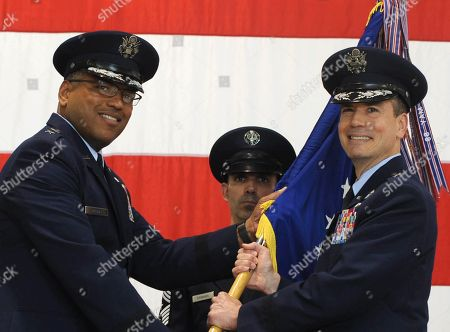 In this photo provided by the U.S. Air Force, Brig. Gen. Paul W. Tibbets IV, right, receives the the 509th Bomb Wing guidon from Air Force Maj. Gen. Richard Clark, left, to take over leadership of the United States' aging fleet of nuclear-capable B-2 stealth bombers at Whiteman Air Force Base, Mo. Tibbets, a grandson and namesake of the man who piloted the B-29 that dropped the atomic bomb on Hiroshima, replaces Brig. Gen. Glen VanHerck, who has led the wing since February 2014