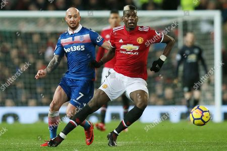 Stephen Ireland of Stoke City challenges Paul Pogba of Manchester United