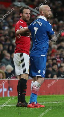 Stephen Ireland of Stoke City shares a joke with Juan Mata of Manchester United