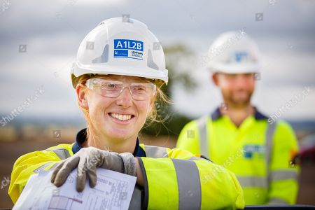 Stock Photo of FILE Picture shows A1L2B - Carillion JV with Morgan Sindall - A1 Leeming to Barton Project. Branded safety helmet worn by Carillion site engineer Emily Rainsley with Aaron Ralston in background. (28/08/2014)  Construction giant Carillion has gone into liquidation, threatening thousands of jobs. The move came after talks between the firm, its lenders and the government failed to reach a deal to save the UK's second biggest construction company. Carillion ran into trouble after losing money on big contracts and running up huge debts of around £1.5bn. Its failure means the government will have to provide funding to maintain the public services run by Carillion.