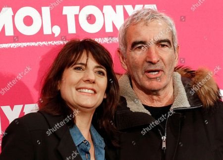 Former France soccer team coach Raymond Domenech, right, and his wife, Estelle Denis pose as they arrive for the premiere of the film I, Tonya, in Paris