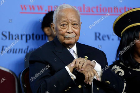 Former New York Mayor David Dinkins listens to remarks at the National Action Network House of Justice, in New York, . Prominent lawmakers and community leaders took aim at President Donald Trump's racial rhetoric at a New York commemoration of Martin Luther King Jr.'s birthday