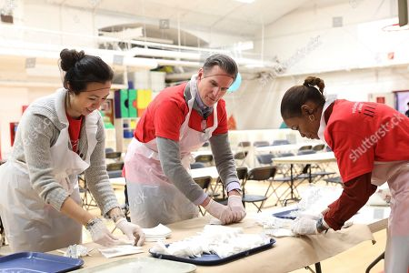 Macy's CEO, Jeff Gennette and volunteers prepare cutlery for the soup kitchen in honor of Martin Luther King Jr. for a Day of Service in partnership with Macy's and New York Urban League Young Professionals at Cathedral of St. John the Divine on in Harlem, NY