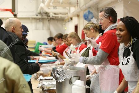 Macy's CEO, Jeff Gennette and volunteers serve breakfast in the church soup kitchen in honor of Martin Luther King Jr. for a Day of Service in partnership with Macy's and New York Urban League Young Professionals at Cathedral of St. John the Divine on in Harlem, NY