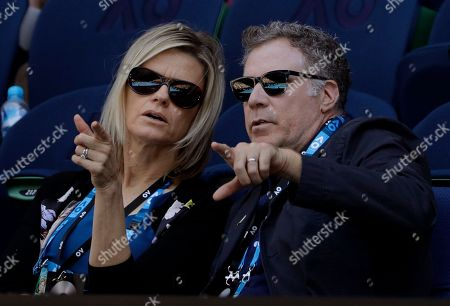 U.S. actor Will Ferrell and his wife Viveca Paulin watch the first round match between Karolina Pliskova of the Czech Republic and Paraguay's Veronica Cepede Royg at the Australian Open tennis championships in Melbourne, Australia