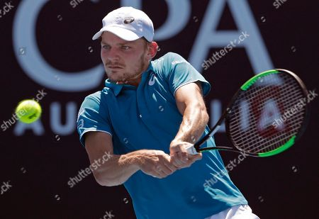 Belgium's David Goffin makes a backhand return to Germany's Matthias Bachinger during their first round match at the Australian Open tennis championships in Melbourne, Australia