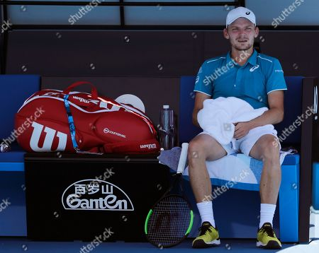 Belgium's David Goffin sits on a char during a break while playing Germany's Matthias Bachinger in their first round match at the Australian Open tennis championships in Melbourne, Australia