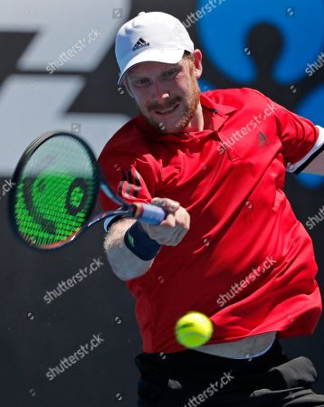 Germany's Matthias Bachinger makes a forehand return to Belgium's David Goffin during their first round match at the Australian Open tennis championships in Melbourne, Australia