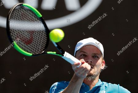 Belgium's David Goffin makes a forehand return to Germany's Matthias Bachinger during their first round match at the Australian Open tennis championships in Melbourne, Australia