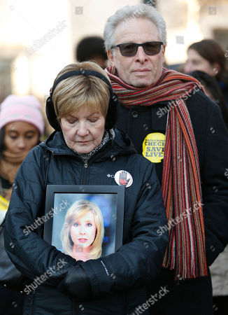 "Stock Photo of Barbara Parker, Andy Parker. Parents of slain TV reporter Alison Parker, Barbara and Andy Parker, listen to speeches as they hold a photo of their daughter during an anti-gun violence rally at the Capitol in Richmond, Va., . Newly sworn-in Virginia Gov. Ralph Northam's push for stricter gun laws was dealt a swift defeat Monday, with a Republican-led Senate panel blocking legislation to increase background checks and limit guns at public rallies. After the vote, Northam told a crowd of gun-control advocates who held the rally on Capitol Square that he was ""just getting warmed up"" and would continue to press the issue forcefully"