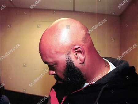 "Marion Hugh ""Suge"" Knight. This evidence photo by the Los Angeles County Sheriff's Office, released by Los Angeles Superior Court, is one of a series of photos showing Marion ""Suge"" Knight after his arrest after an altercation in which his vehicle struck two men in Compton, Calif., on . One man was killed, the other injured. Officials took these photos to show Knight's physical condition after the incident. The photos have been entered into evidence in the court proceedings"