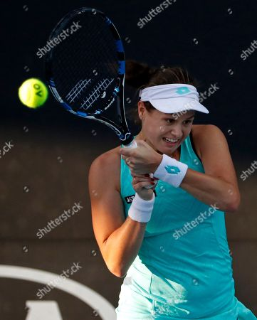 Slovakia's Jana Cepelova makes a backhand return to United States Lauren Davis during their first round match at the Australian Open tennis championships in Melbourne, Australia