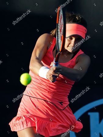 United States Lauren Davis makes a backhand return to Slovakia's Jana Cepelova during their first round match at the Australian Open tennis championships in Melbourne, Australia