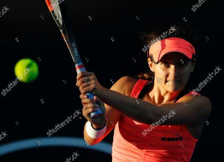 United States' Lauren Davis makes a backhand return to Slovakia's Jana Cepelova during their first round match at the Australian Open tennis championships in Melbourne, Australia